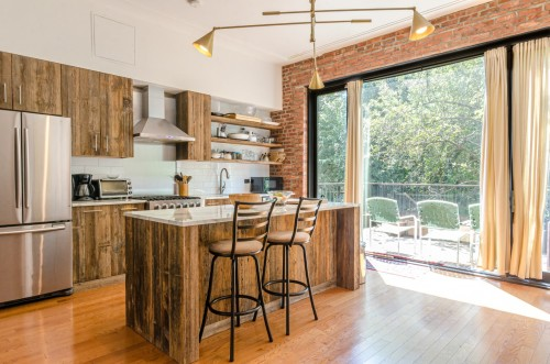 Kitchen-Rusty-wooden-cabinets-with-big-window-opening-and-brick-masonry.jpg