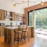 Kitchen-Rusty-wooden-cabinets-with-big-window-opening-and-brick-masonry