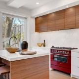 Kitchen-with-Wooden-texture-cabinet-and-large-windows