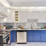 Kitchen-with-blue-white-cabinets-and-white-ceiling