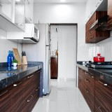 compact-kitchen-with-wooden-texured-cabinets