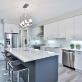 metallic-chairs-inside-kitchen-with-white-cabinets-and-lime-ambient-lights