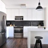 white-kitchen-cabinets-with-wooden-flooring