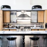 wooden-cabinets-with-metallic-counter-and-stools