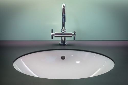 Black-and-White-Vanity-Top-With-Stainless-Steel-Faucet.jpg