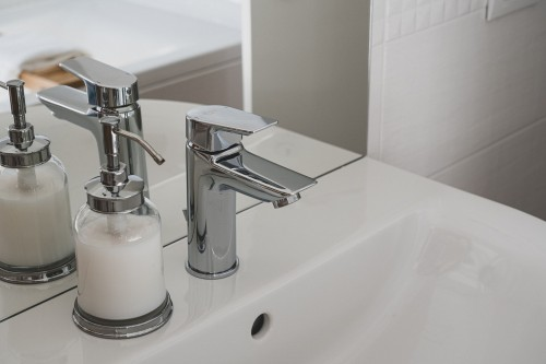 Close-up-Photo-of-White-Ceramic-Sink-With-Stainless-Steel-Faucet.jpg