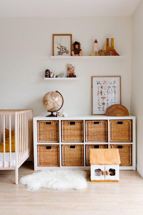 Interior-of-children-bedroom-with-wooden-furniture-and-toys-and-globe-placed-on-shelves-in-room.jpg