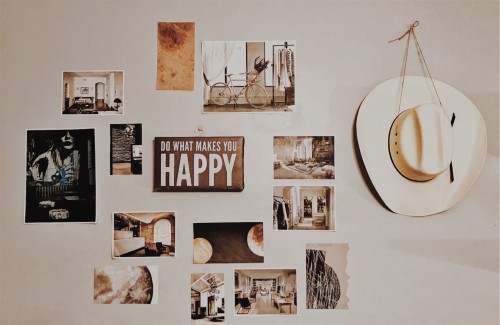 Photo-of-Brown-and-White-Photo-Frames-Hang-in-Wall.jpg
