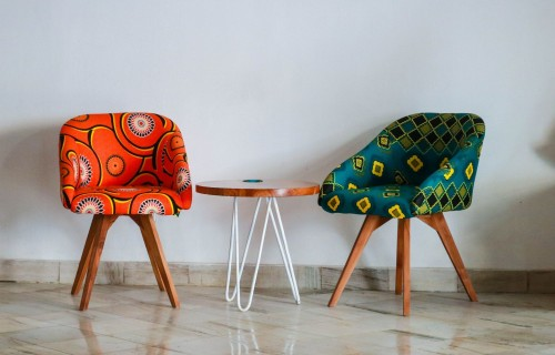 Two-Assorted-color-Padded-Chairs-Near-Side-Table.jpg