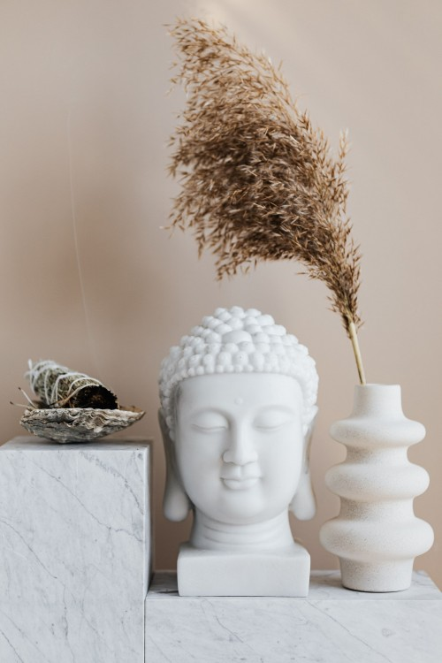 Vase-with-dried-herb-arranged-with-Buddha-bust-and-sage-smudge-stick-in-bowl.jpg