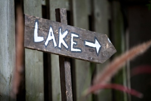 A-close-up-on-a-hand-painted-wooden-sign-which-reads-Lake-with-an-arrow-pointing-right.-You-know-where-to-find-me..jpg