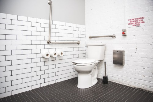 A-public-bathroom-outfitted-with-handrails-to-help-the-handicapped-and-people-with-disabilities-use-the-toilet..jpg