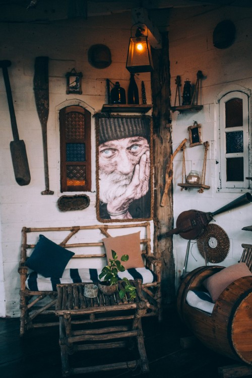 A-rustic-room-provides-a-home-for-all-kinds-of-antiques-and-hand-made-wooden-furniture..jpg