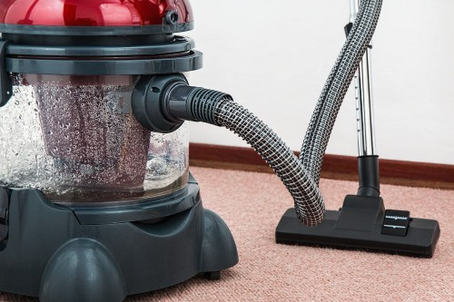 Black-and-Red-Canister-Vacuum-Cleaner-on-Floor.jpg