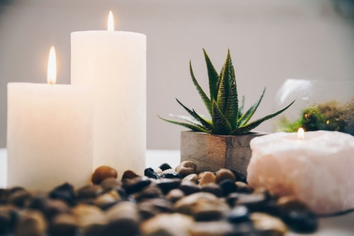 Candle-flames-hold-still-beside-succulents-and-stones.-These-natural-spa-decorations-help-you-connect-to-the-elements-of-the-earth.jpg
