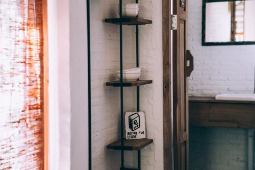Minimalist-shelves-provide-modern-decor-while-being-contrasted-against-rustic-white-brick..jpg