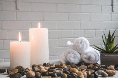 This-spa-feels-serene-with-lit-candles-natural-pebbles-and-fluffy-towels..jpg