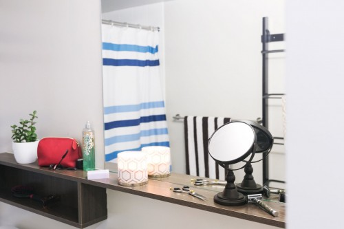 Two-kinds-of-mirrors-in-a-bathroom.-Bathroom-products-lay-on-a-shelf..jpg
