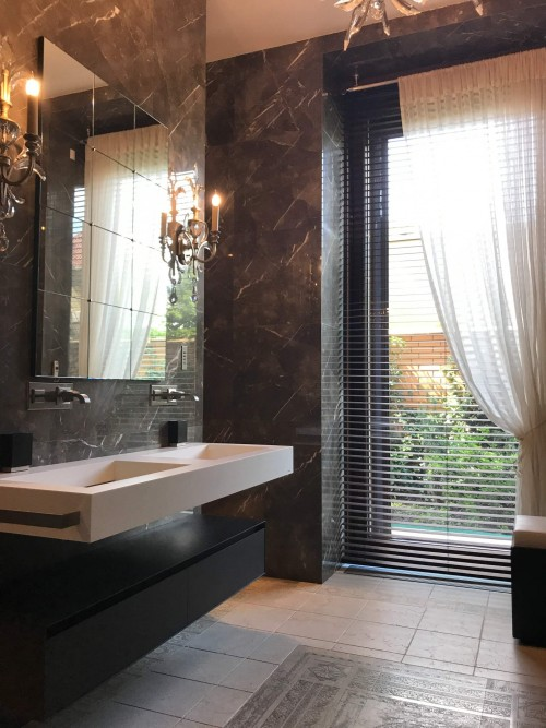 Double-white-sink-and-brown-wall-bathroom.jpg