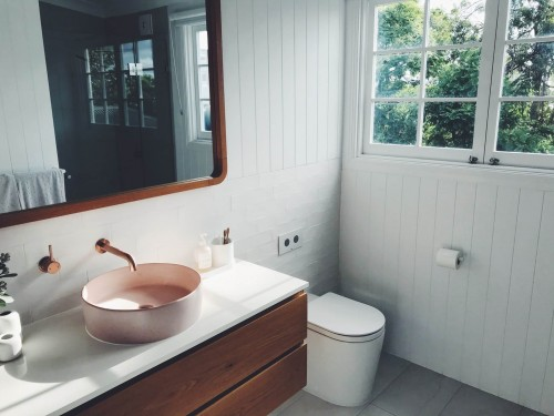 Round-sink-with-stainless-steel-faucent-bathroom.jpg