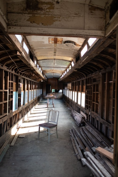 Sunlight-bathes-dilapidated-train-car-with-chair-in-the-centre..jpg