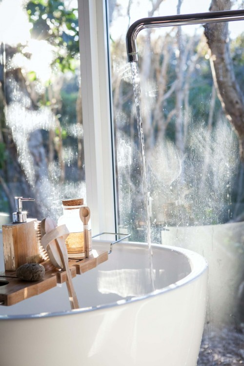 White-sink-and-stainless-steel-faucent-beside-window.jpg