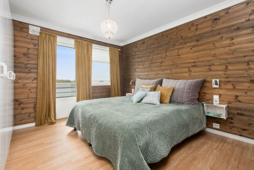 bedroom-containing-various-item-and-wooden-designed-wall.jpg