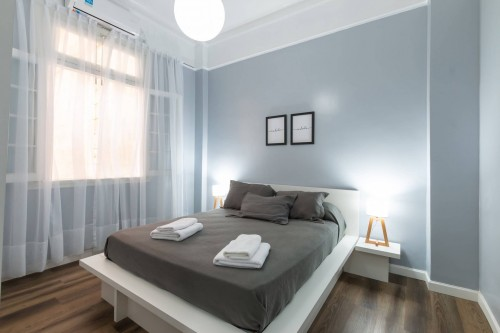 gray-bed-sheet-on-bed-and-nightstand-lamp-inside-bed.jpg