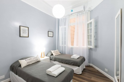gray-bed-with-white-pillow-and-white-color-wall.jpg