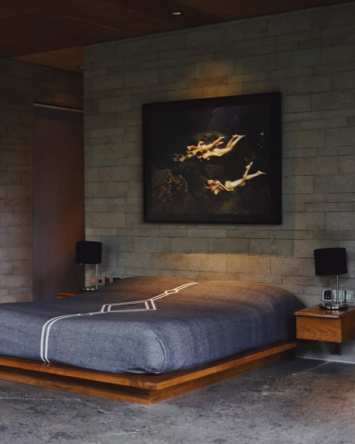 painting-on-wall-and-wooden-designed-bed.jpg