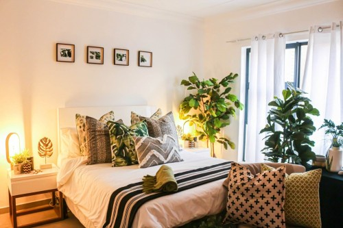 plant-in-bedroom-and-multiple-pillow-on-bed.jpg