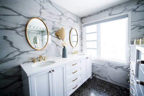 round-shape-mirror-with-sink-and-white-frame-window.jpg