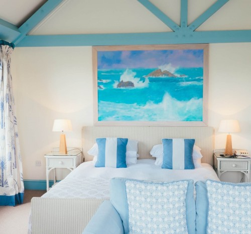white-and-blue-pillow-with-blue-designed-frame-on-wall.jpg