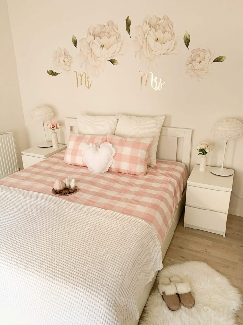white-and-pink-bed-sheet-and-background-wall-designed-with-flawers.jpg