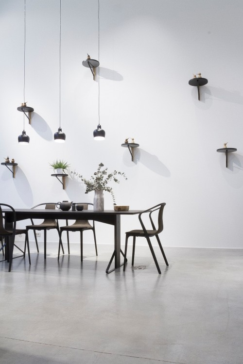 black-and-white-lamp-above-black-dining-set-near-white-wall-photo.jpg