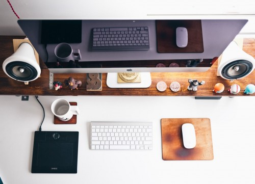 turned-of-monitor-with-two-white-speaker-near-keyboard-and-mouse-on-brown-wooden-table.jpg