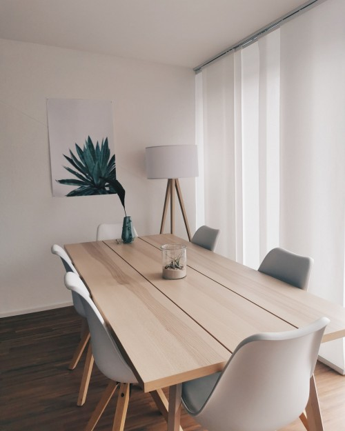agave-painting-and-sixchair-around-the-brown-wooden-7-piece-table-and-plant-pot-on-a-table-inside-the-room.jpg