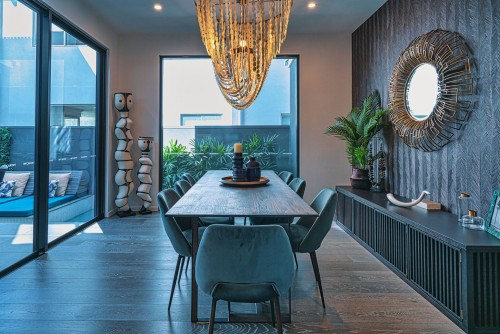 brown-wooden-table-with-chair-beside-sliding-rack-and-modern-interior-design-on-wall-dining-room-photo.jpg