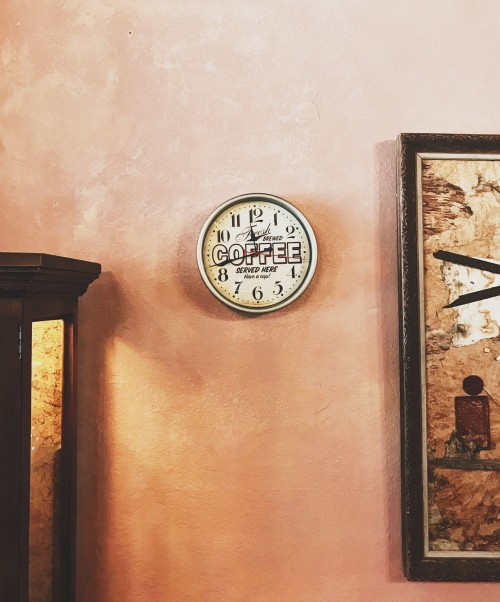 round-wall-clock-and-frame-on-wall-inside-the-room.jpg