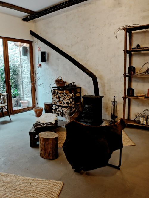 black-metal-fireplace-near-brown-wooden-shelf-and-wooden-table-and-black-chair-inside-the-room.jpg