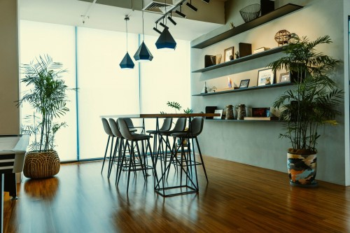 brown-wooden-table-near-glass-wall-photo-and-diamond-shape-black-lamp-above-the-dining-set-photo.jpg