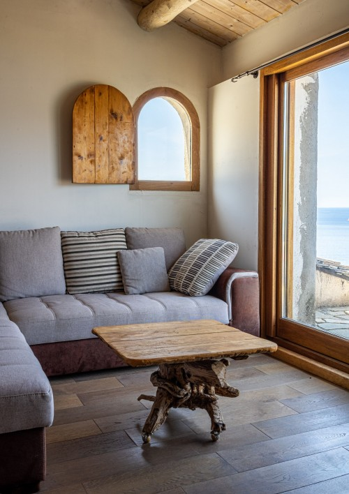 brown-wooden-table-with-gray-sofa-on-top-throw-pillow-near-window-living-room.jpg