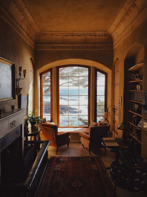 empty-chairs-fronting-window-and-drawer-and-wooden-shelf-inside-living-room.jpg