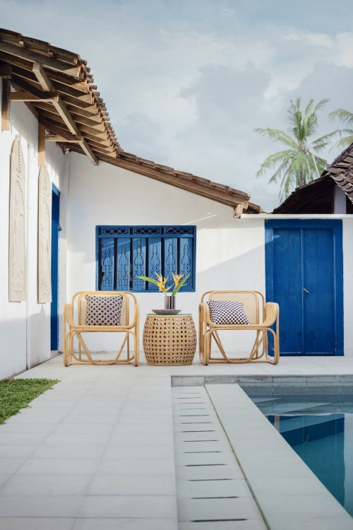 flower-in-pot-on-wicker-table-and-two-chairs-near-swimming-pool-interior-photo.jpg