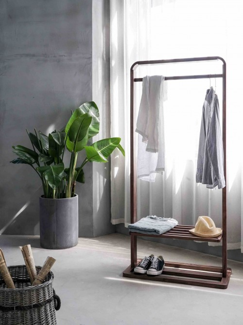 gray-dress-shirt-hang-on-brown-wooden-rack-in-front-of-window-with-white-curtain-and-plant-pot-inside-room-photo.jpg