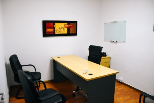 home-office-brown-with-black-desk-and-black-chair-near-wall-and-glass-board-on-white-wall-photo.jpg