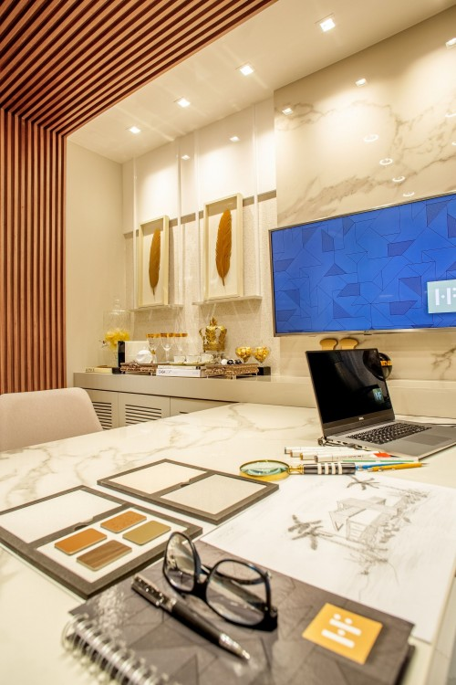 modern-interior-designed-living-room-with-laptop-on-table-near-turned-on-flat-screen-tv-on-wall-living-room-photo.jpg