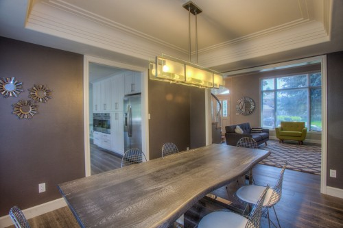 modern-interior-designed-shaped-brown-wooden-designed-table-with-cahir-inside-living-room-photo.jpg