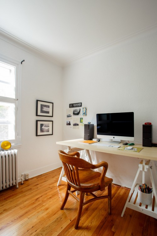 silver-iMac-with-magic-mouse-and-speakers-on-wooden-table-near-brown-wooden-chair-inside-home-office.jpg