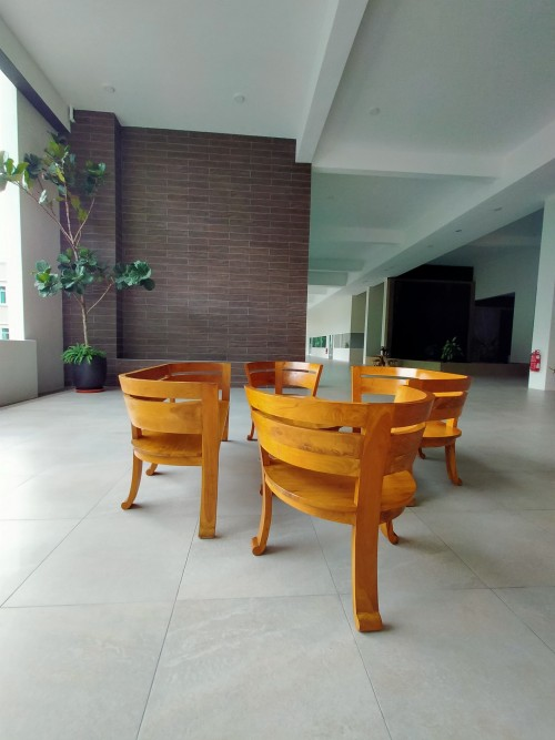 two-wooden-bench-with-two-chair-around-the-table-on-surface-modern-boho-interior-photo.jpg
